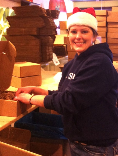 Brandy, surrounded by our packaging supplies, is making holiday gift boxes as fast as the orders pour in.
