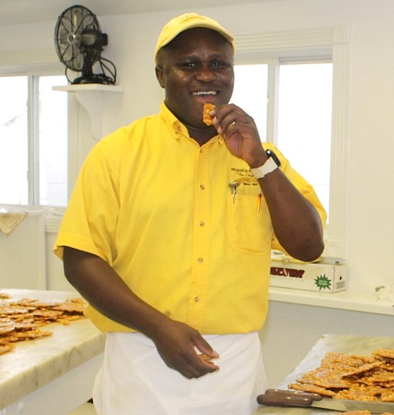 Carnel, Original Murdick's Fudge master sweets maker, samples his latest batch of peanut brittle.